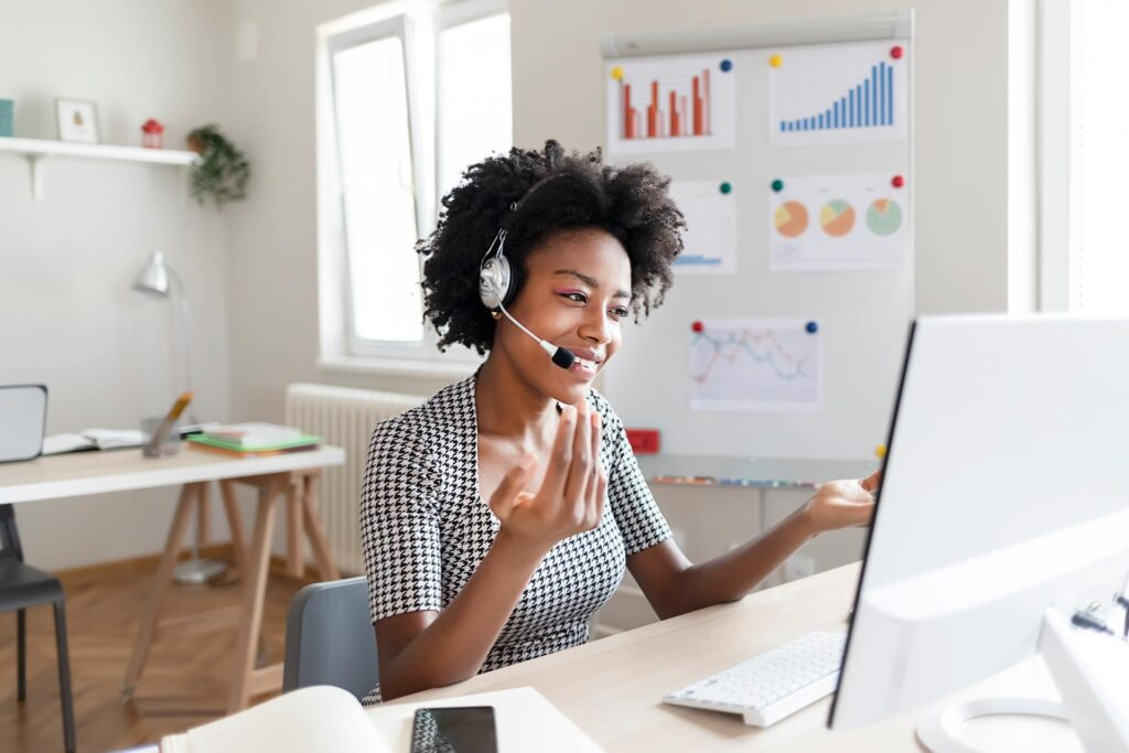 Women talking on headset looking at computer